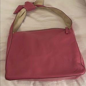 Pink leather handled handbag